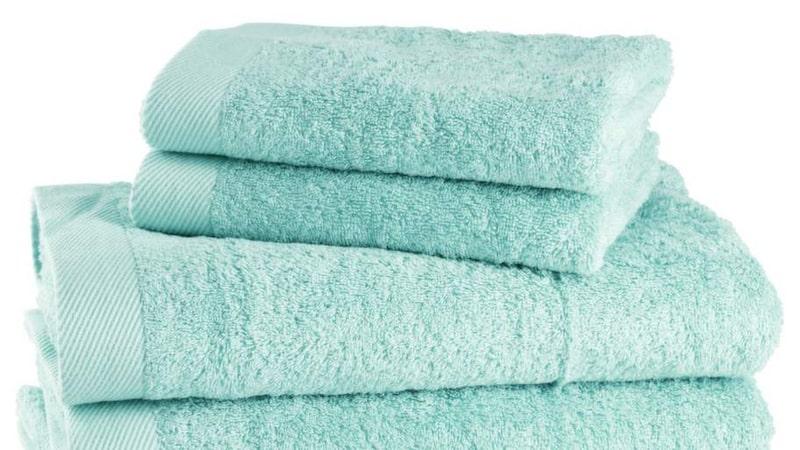 Hoppa över sköljmedel och torktumlare när du tvättar handdukar.