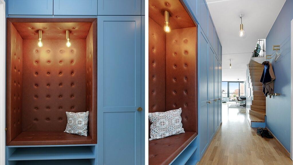 Inbyggd smart väggförvaring och häftig skinnsoffa.